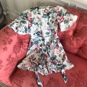 Quiz flower romper with open back and ruffles